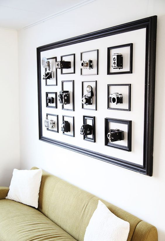 a frame with frames inside and cameras in each of the frames is a bold artful display