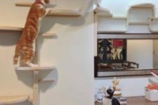 13 turn IKEA Frosta stools into a large and creative cat tree along the walls