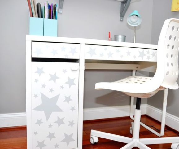 IKEA Micke desk spruced up with star-printed adhesive paper for a kids' space