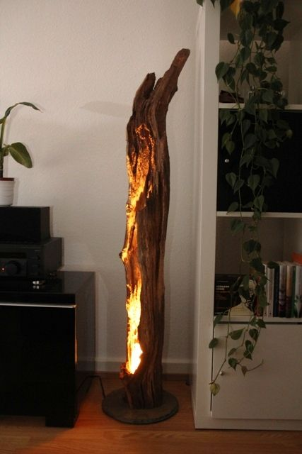 a floor lamp made of a piece of driftwood and a bulb inside is a chic natural touch
