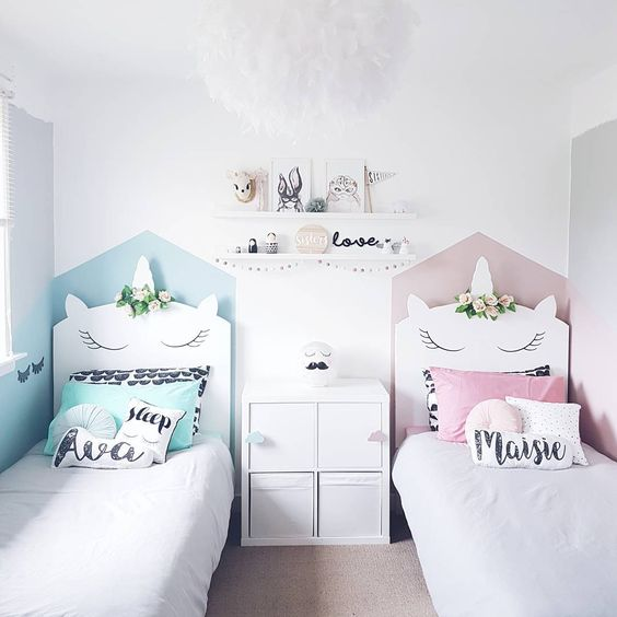 a shared nursery with unicorn-shaped beds is the cutest space ever