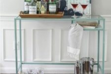 14 a stylish Vittsjo home bar with an acrylic shelf down added for storage