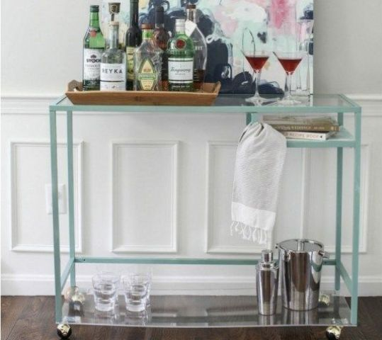 a stylish Vittsjo home bar with an acrylic shelf down added for storage