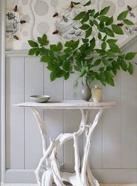 a little coffee table of driftwood as legs and a thin white wooden tabletop for a small entryway