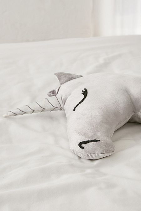 a velvet unicorn pillow in grey will spruce up any bed  - a kid or an adult one