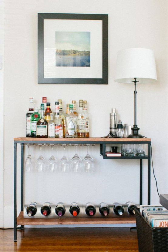 an IKEA Vittsjo desk turned into a comfy home bar with wine bottle storage and a glass holder