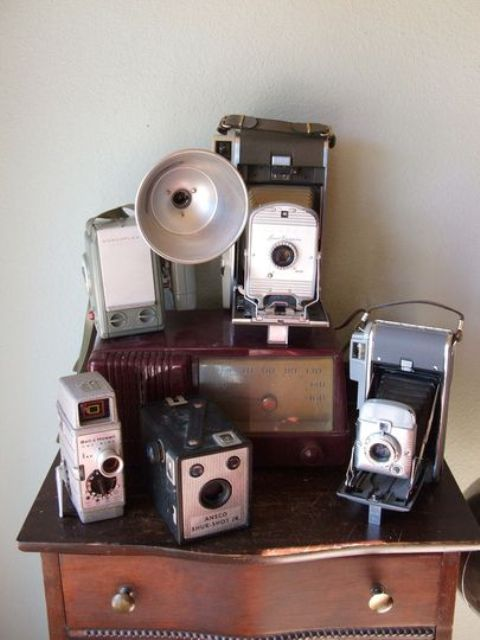 take a vintage cabinet and place all your cameras on it to keep the theme