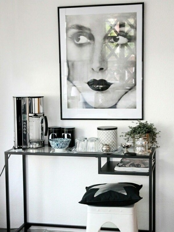 an IKEA Vittsjo desk used as a coffee station in the living room and a storage for magazines