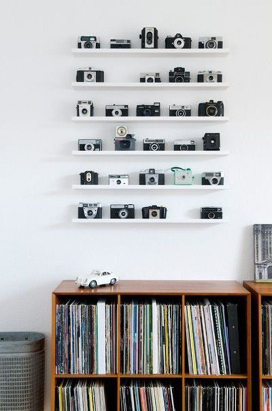 white ledges by IKEA are ideal for displaying vintage cameras and won't distract attention from them