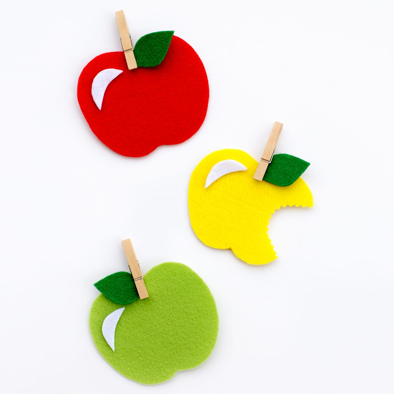 DIY colorful felt apples to use as magnets or gifts