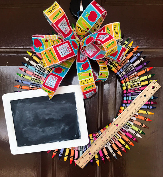 DIY colorful crayon wreath with a chalkboard and an apple (via www.etsy.com)