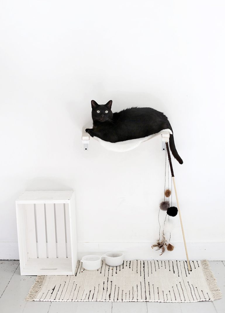 DIY wall-mounted cat hammock (via themerrythought.com)