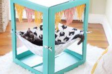 DIY bright cardboard box with a hanging hammock