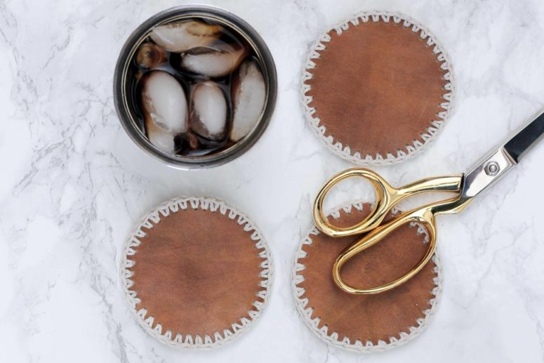 DIY leather coasters with a crocheted hem (via makeanddocrew.com)