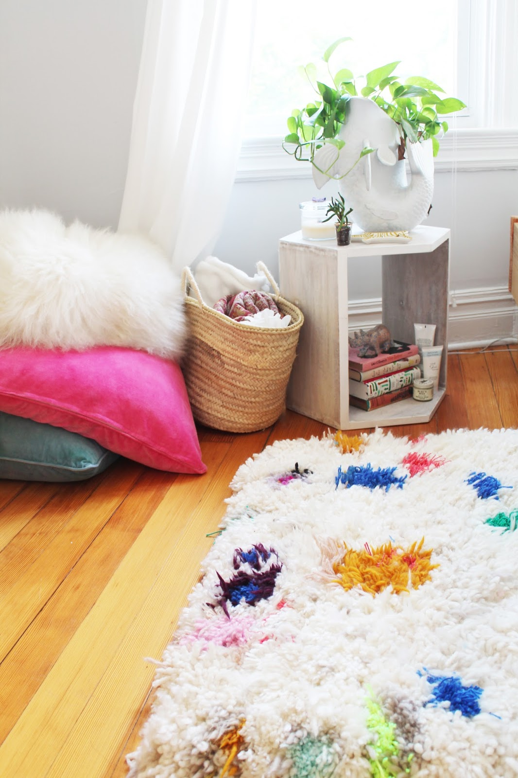 DIY shag rug of neutral and colorful yarn