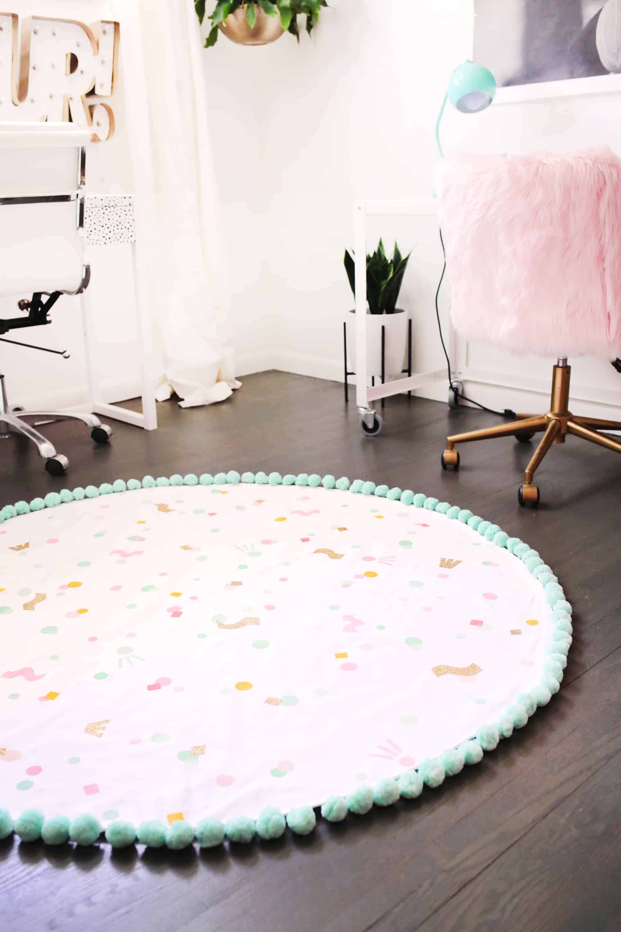 DIY washable confetti rug with pompom trim