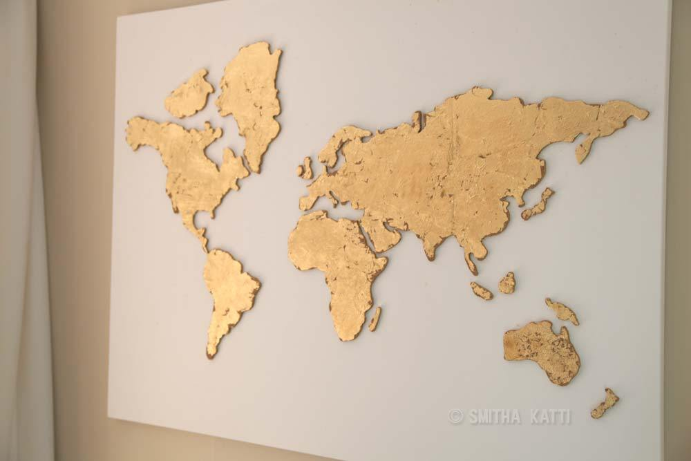 DIY shiny gold leaf cork world map