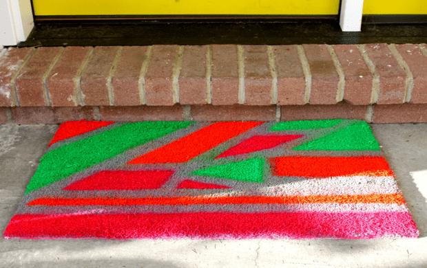 DIY custom welcome mat with a colorful graphic design