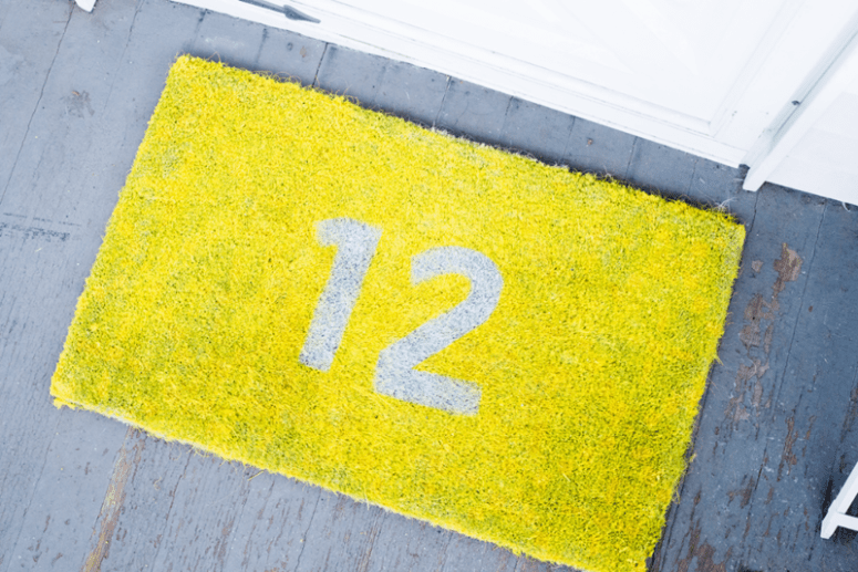 DIY graphic neon doormat with your house number (via www.thehomesteady.com)