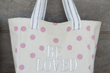 DIY canvas market tote decorated with pens and paints