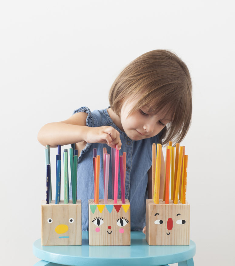 DIY wood block pencil holders with mini faces (via mermagblog.com)