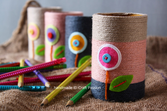 DIY pencil holders with colorful twine and floral appliques (via www.craftpassion.com)