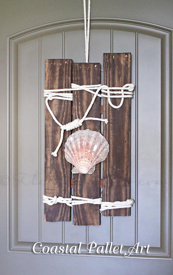 DIY coastal pallet art with rope and a large sea shell (via www.kleinworthco.com)