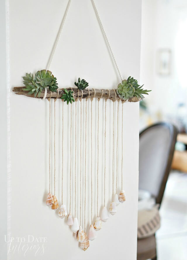 DIY modern sea shell door hanging with fake succulents (via www.homemadebycarmona.com)