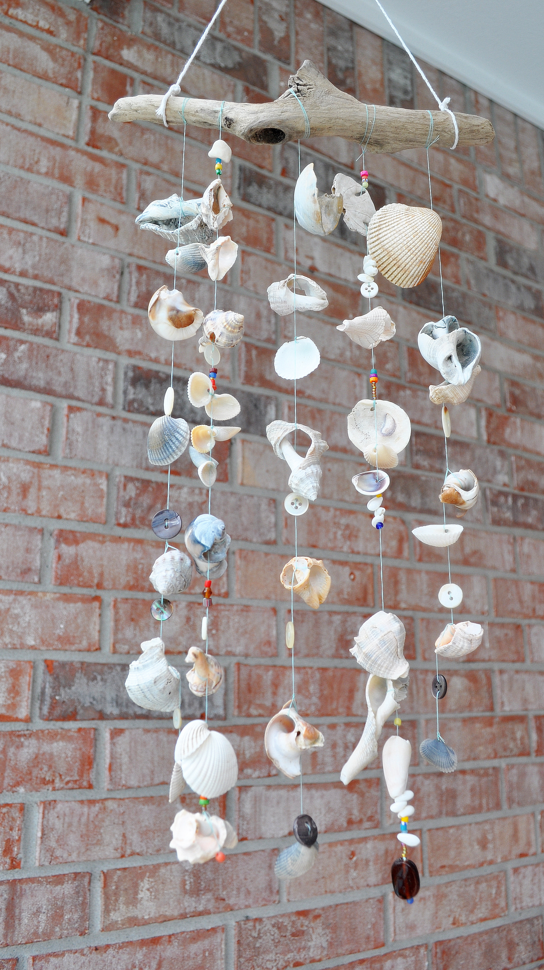 DIY beach wind chimes with sea shells, buttons and beads