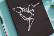 DIY black embroidered notebook with a geometric bird