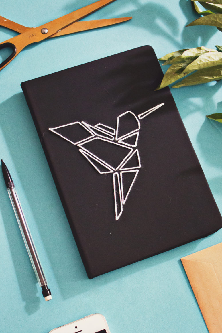 DIY black embroidered notebook with a geometric bird (via www.lanaredstudio.com)