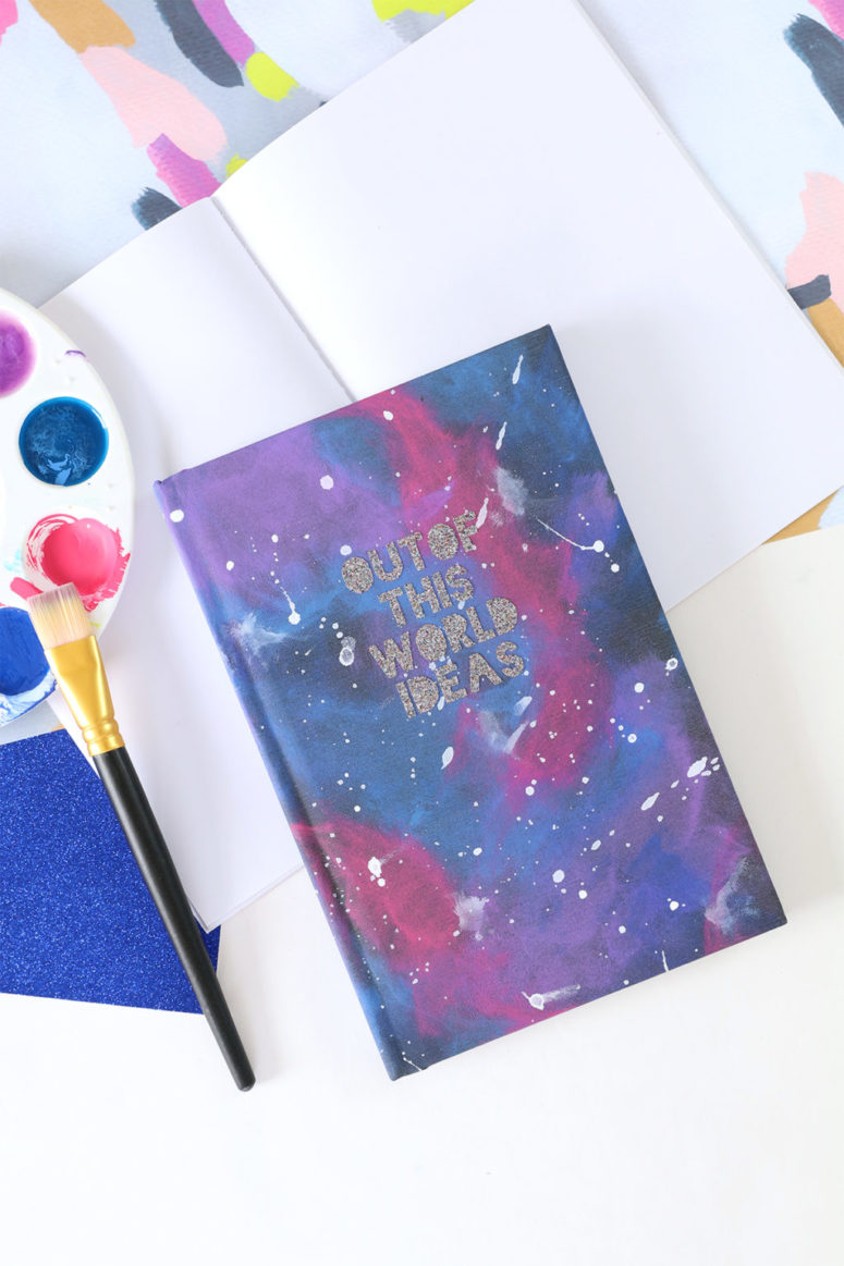 DIY galaxy painted notebook with glitter letters (via damasklove.com)
