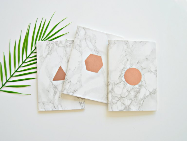 DIY graphic copper and marble notebooks (via yourdiyfamily.com)