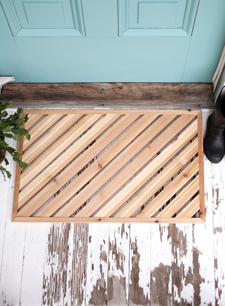DIY geometric wooden doormat of cedar (via themerrythought.com)