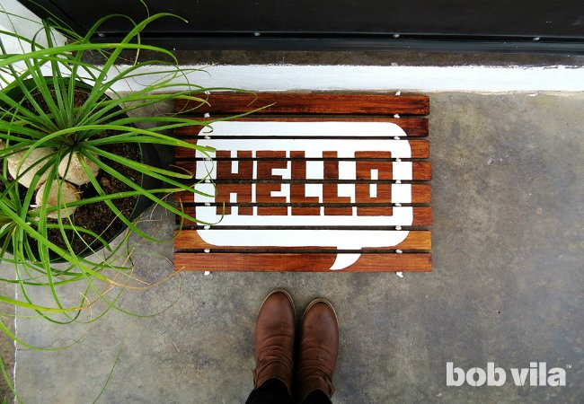 DI Y lumber doormat with HELLO print (via www.bobvila.com)