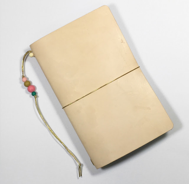 DIY leather travel journal with colorful floral lining
