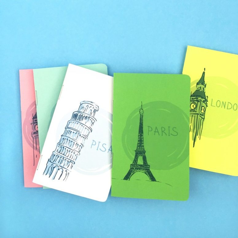 DIY watercolor-inspired travel journals with city names (via maritzalisa.com)
