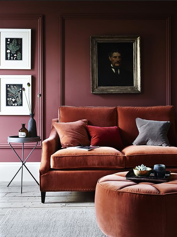 a modern rust sofa and a matching round ottoman is what you need for a strong fall feel