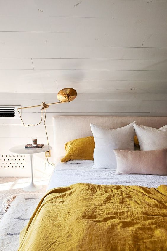 a mustard and white bedding will infuse your bedroom with color and make it bolder