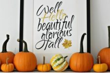 03 orange pumpkins on the mantel and a calligraphy fall sign in a frame for a simple look