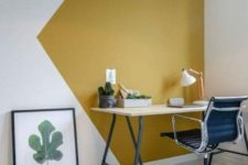 03 the working space is accented with a geometrically stenciled wall in mustard and white