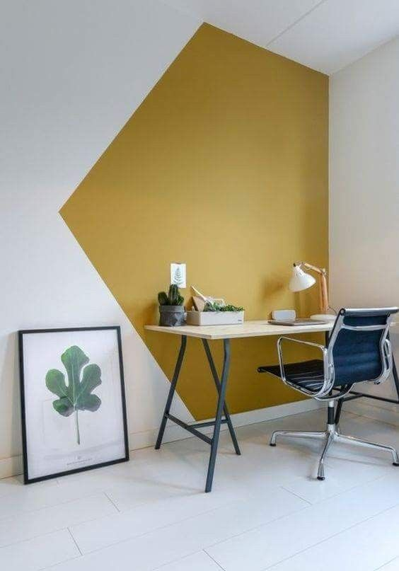 the working space is accented with a geometrically stenciled wall in mustard and white