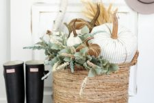 05 a basket with fabric pumpkins of various colors and fresh greenery for cozy rustic decor