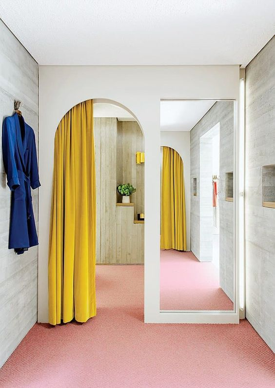 add a touch of color gently separating the spaces at the same time   hang a mustard curtain