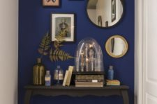 05 an elegant vintage console is highlighted with a super bold blue accent wall