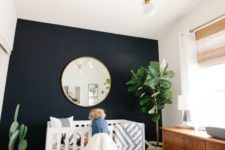 07 a boho chic nursery with a black accent wall for more drama and a contrast