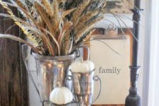 08 a basket with white pumpkins and a large silver cup with wheat and feathers for a boho feel