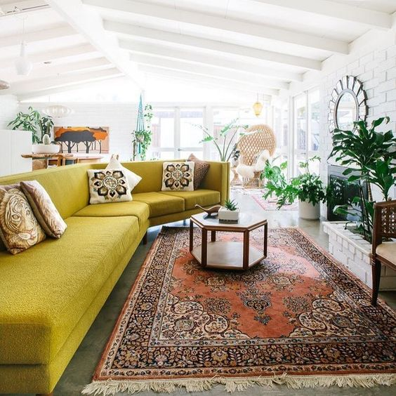 a large sculptural mustard sofa is ideal for a boho space and looks very bold