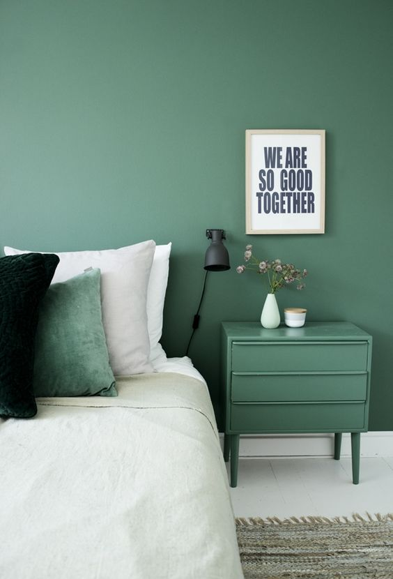 a peaceful green accent wall and a matching nigthstand will create a relaxing ambience in the bedroom
