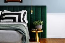 08 an upholstered emerald bed is highlighted with bright gold touches for a chic look